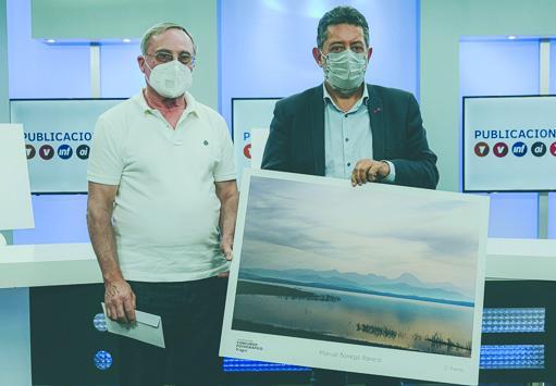 Manuel Borrego, tercer premio por un amanecer en el pantano de Bornos